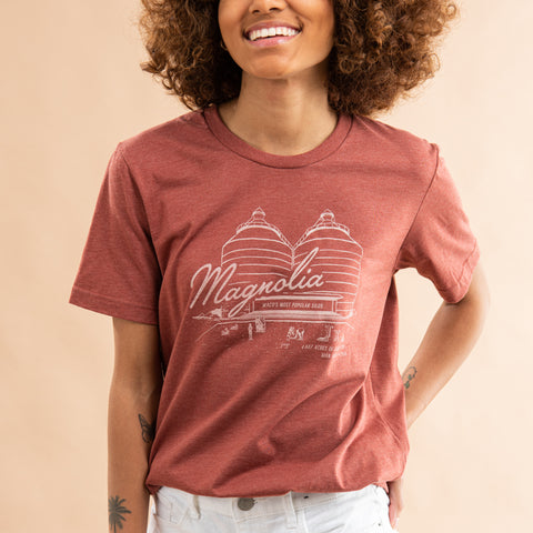 "clay colored t-shirt with the magnolia silos and ""Magnolia"" in script font across chest in white"
