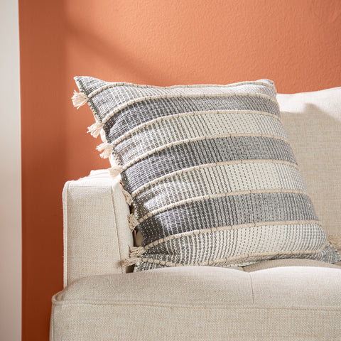 grey and off white striped square pillow with raised texture and side tassels