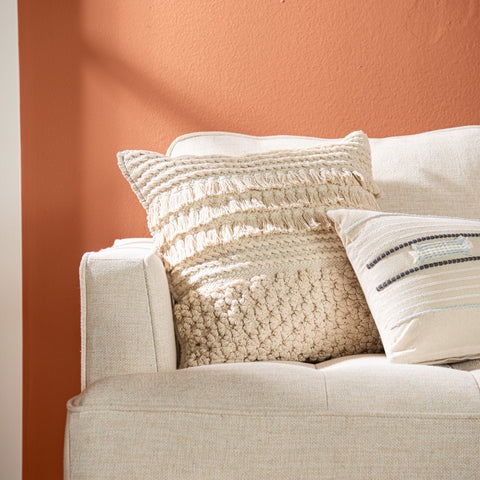 ivory square textured pillow with tassel detail