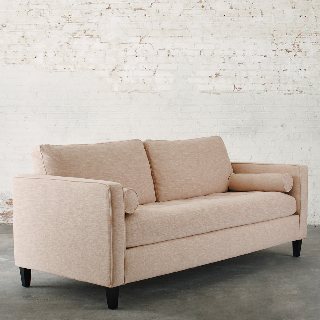 light pink woven fabric mid-century modern sofa