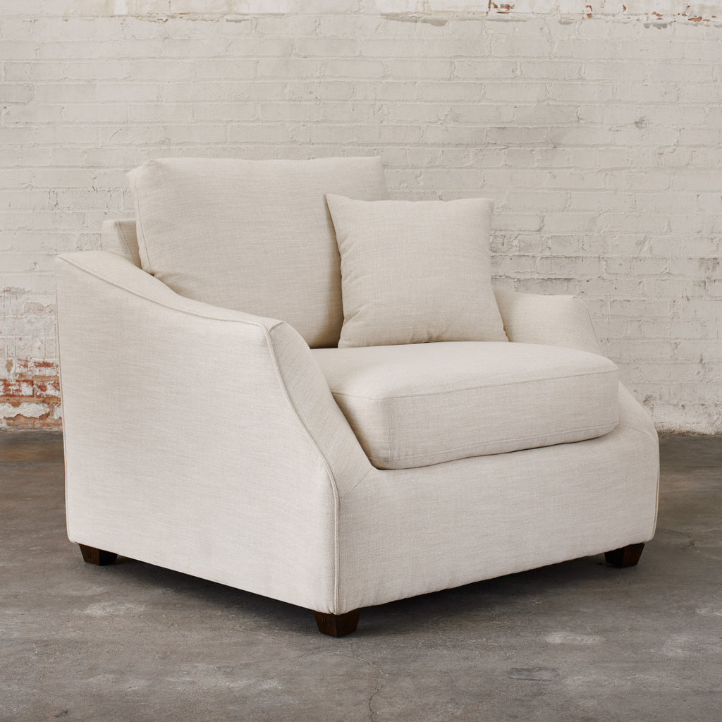 white cloth arm chair