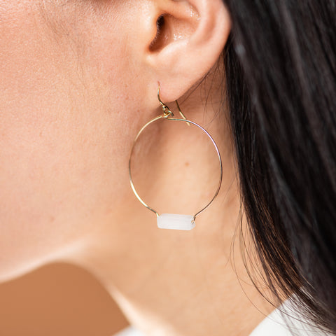 gold hoops earrings with rose quartz rectangular stone at bottom of hoop