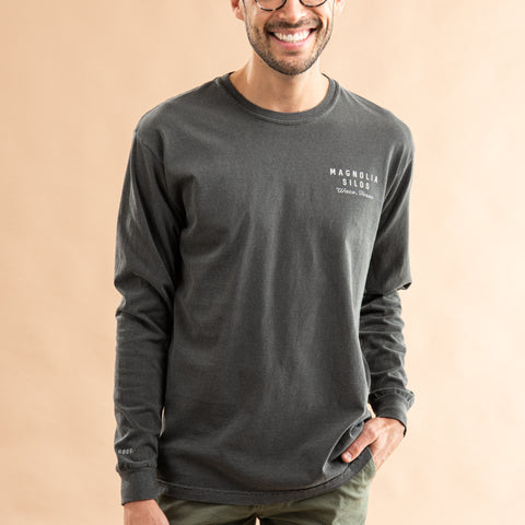 grey long sleeve shirt with magnolia silos mural logo in white on the left chest and across the back