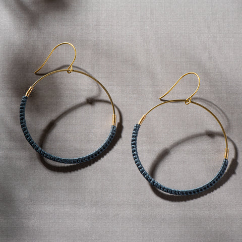 dark teal thread and gold hoop earrings