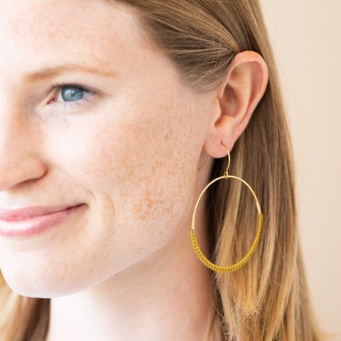 gold thread and gold hoop earrings