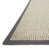 woven jute rug with dark grey border