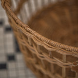 round open weave rattan basket with handles