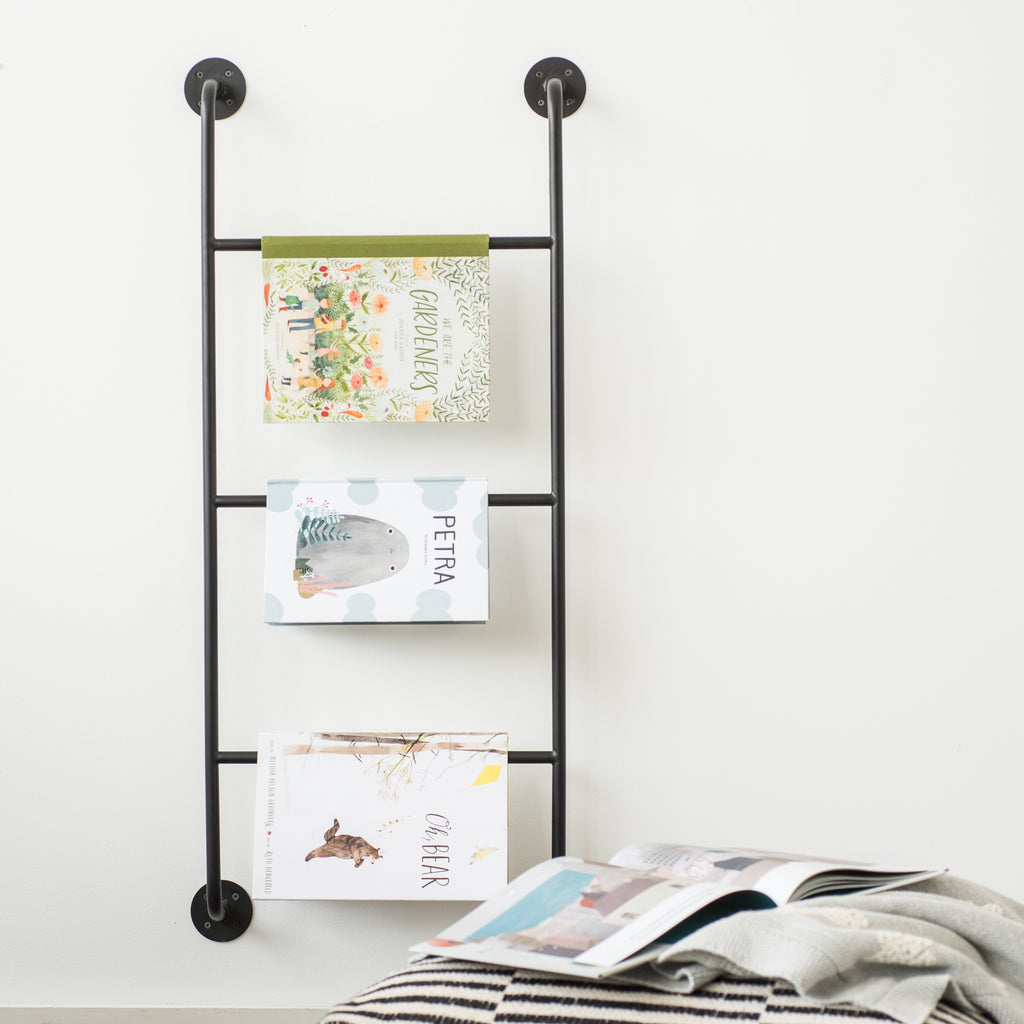 short black metal wall display ladder