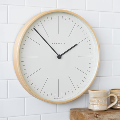 small white-faced wall clock with natural colored plywood frame