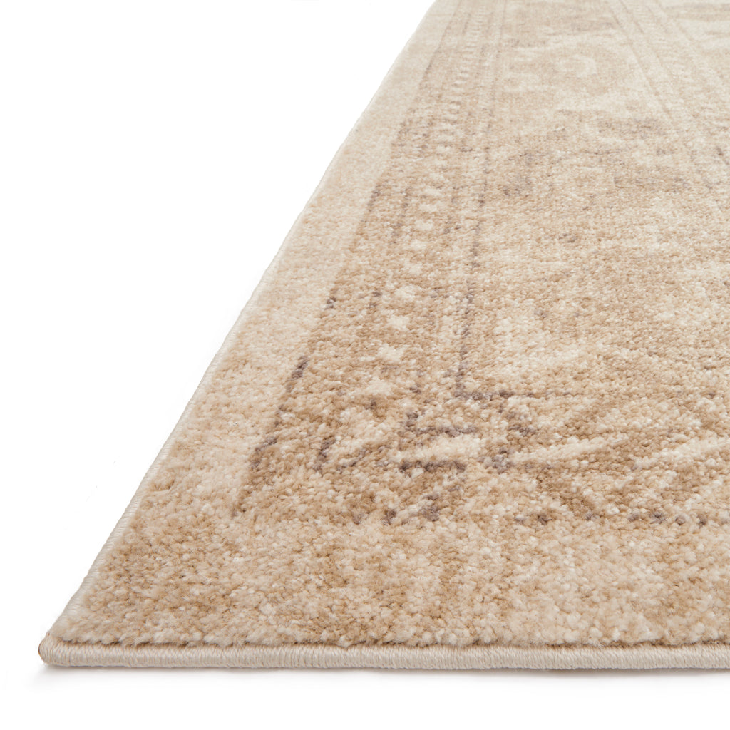 traditional ivory rug with floral pattern and tan undertones