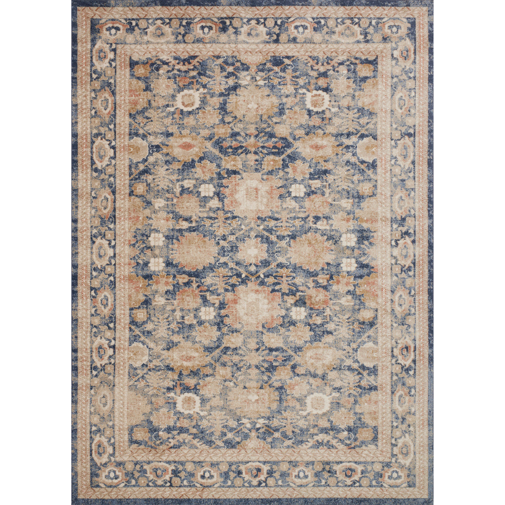 traditional navy rug with light orange detail