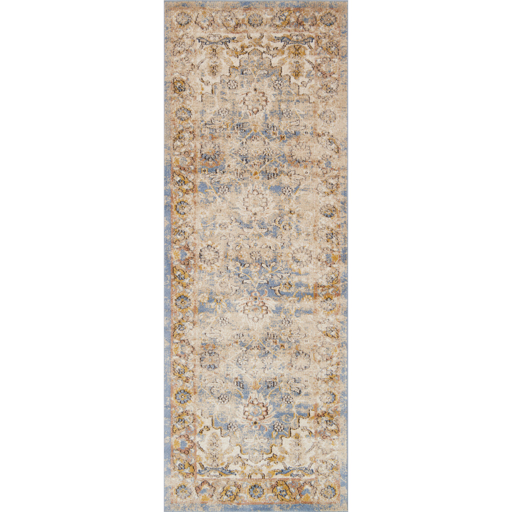 tan distressed runner rug with floral patterns and blue undertones
