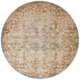 tan distressed circle rug with floral patterns and blue undertones