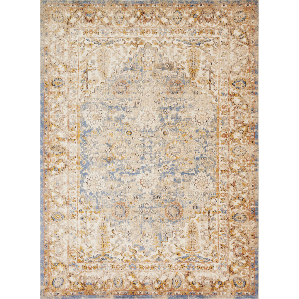 tan distressed rug with floral patterns and blue undertones