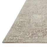 distressed taupe rug with traditional pattern