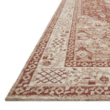 red and ivory rug with traditional pattern
