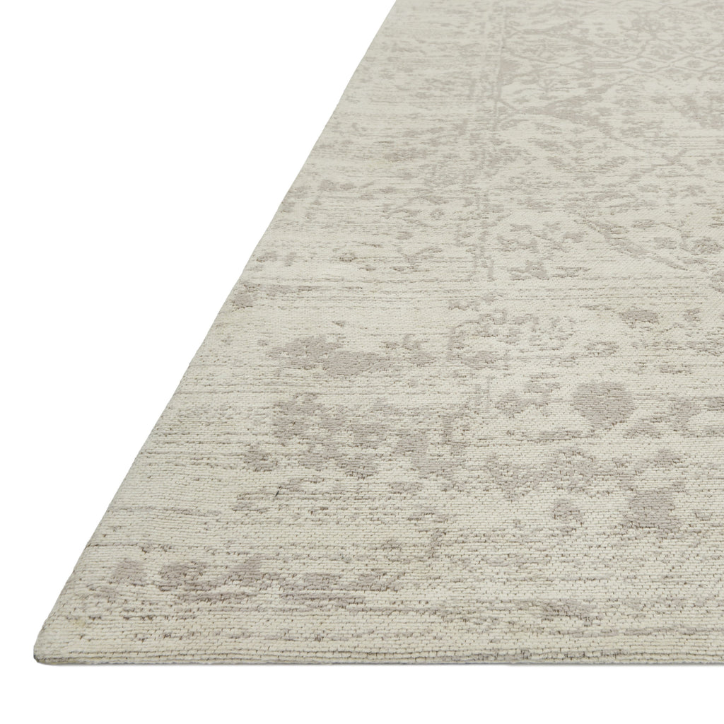 distressed ivory rug with floral patterns