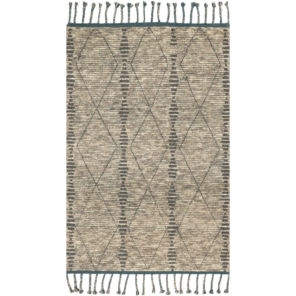 modern beige colored rug with asymmetrical dark grey line detail and tassels