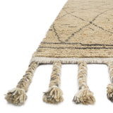 modern natural colored rug with asymmetrical grey line detail and tassels
