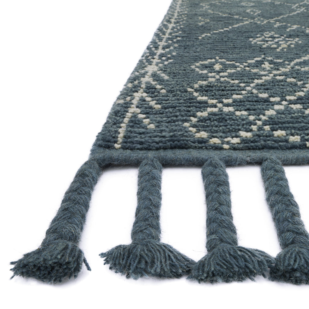 smoky blue modern knotted rug with ivory detail and blue tassels