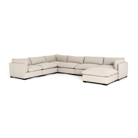 cream fabric L-shaped sectional with ottoman