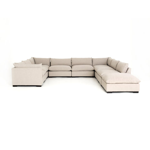 cream fabric u-sectional and ottoman with pillow top