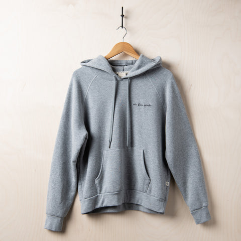 "grey hooded sweatshirt with black script stitching on left chest reading ""vie bien aimee"""