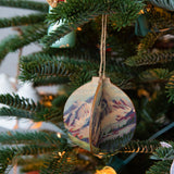 wooden winterscape christmas ornament with various paintings