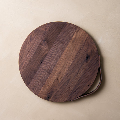 rustic walnut round serving board with leather handle