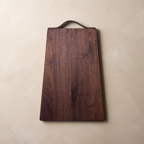 rustic walnut serving board with leather loop handle