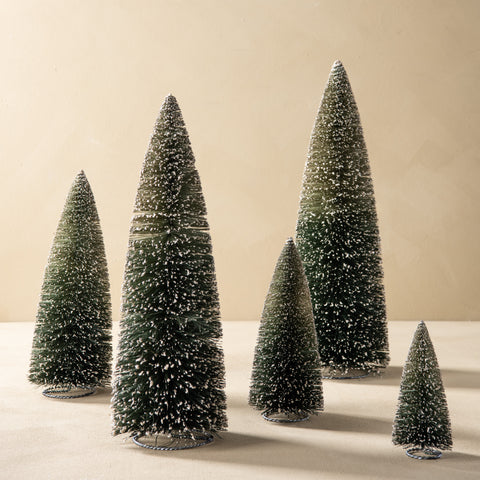 green snowy bottle brush trees in different sizes