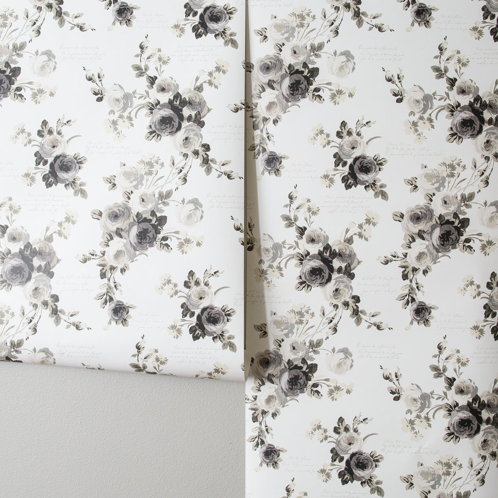white wallpaper with black rose pattern