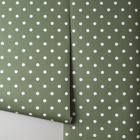 green wallpaper with white polka dots