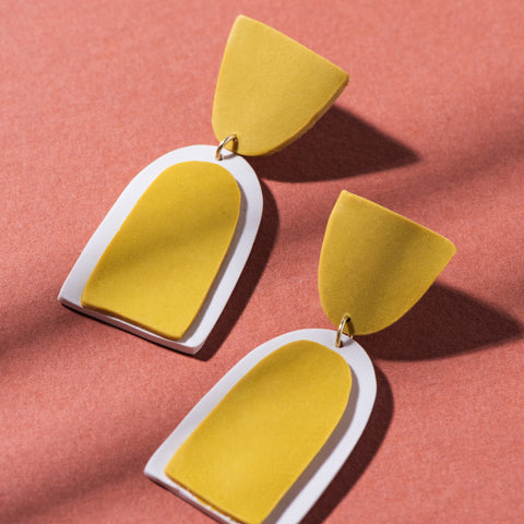 yellow and white clay earrings