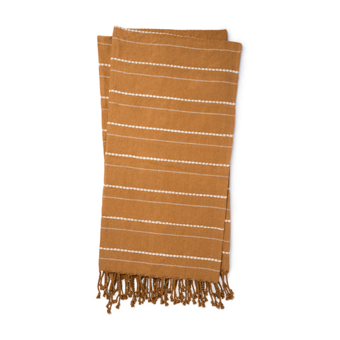 gold throw blanket with white pinstripe detail and gold tassel fringe