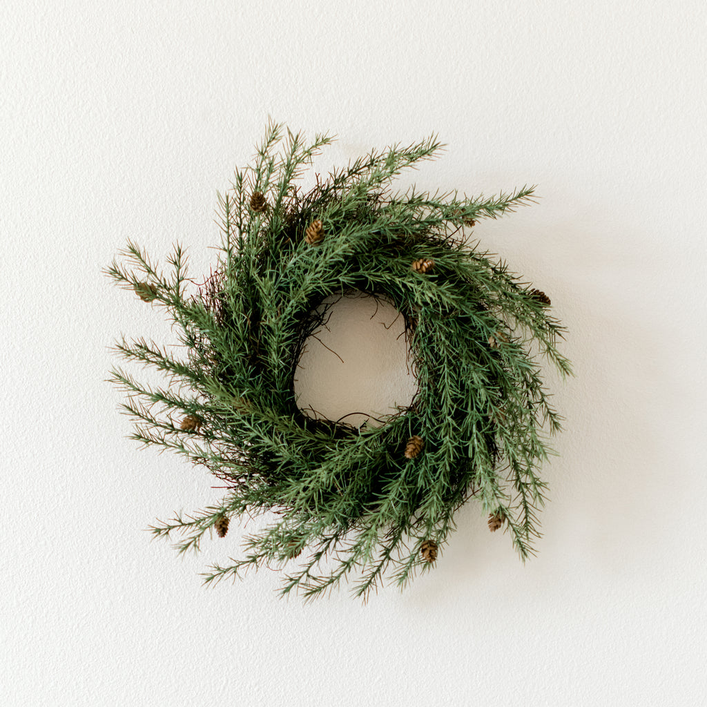 faux pine wreath with small pine cones