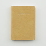 "marigold journal with embossed word ""authenticity"""