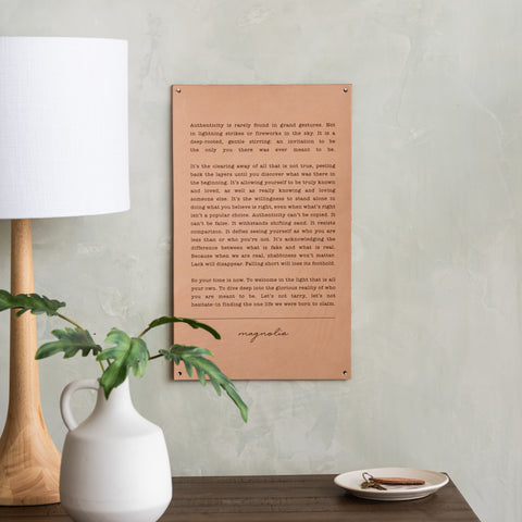 light leather sign with excerpt from magnolia spring 2019 journal about authenticity