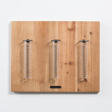 three rain gauge vases on wood plaque