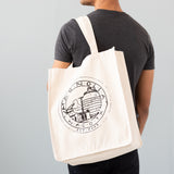 white canvas tote with magnolia market logo and magnolia silos seal logo