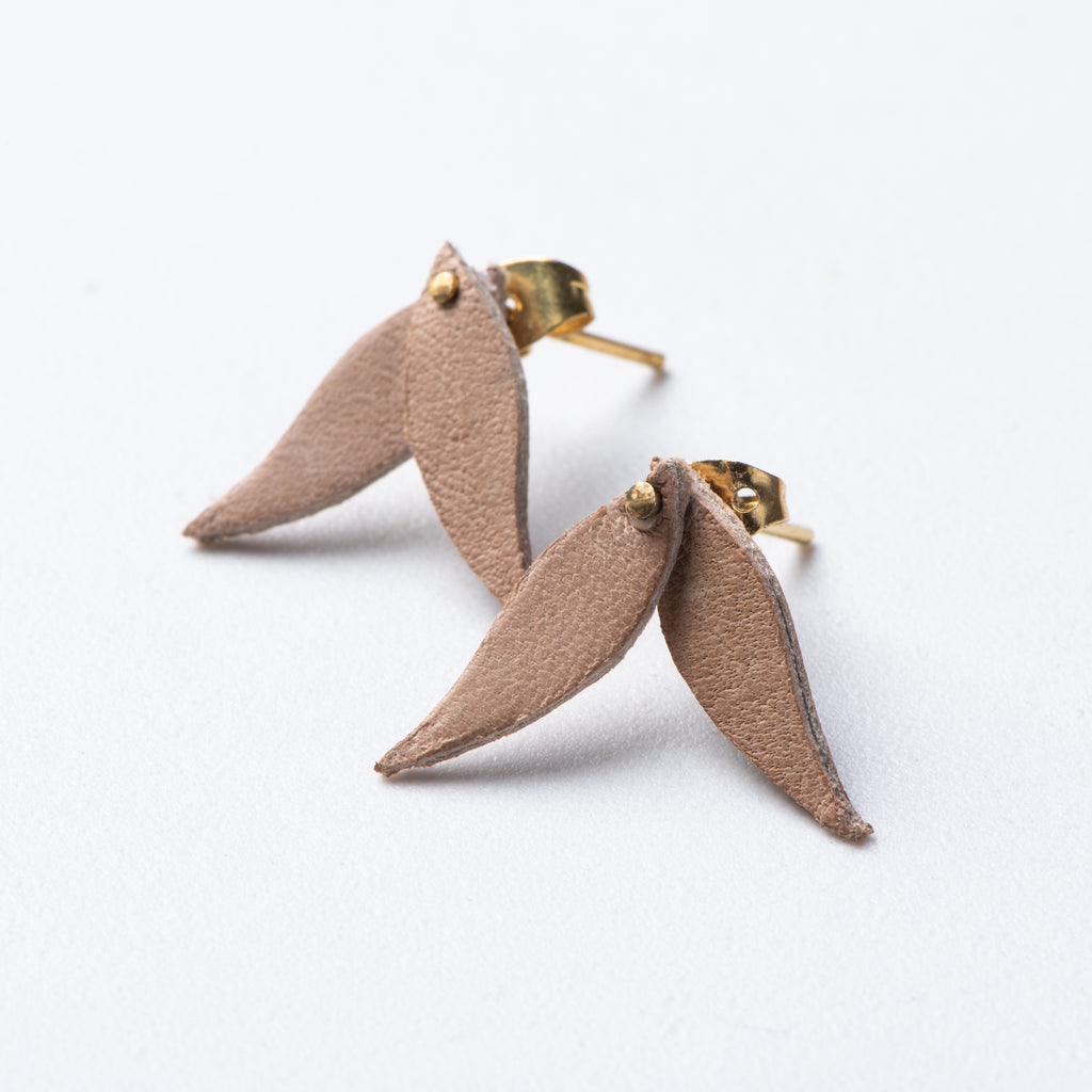 small beige leather leaf shaped earrings