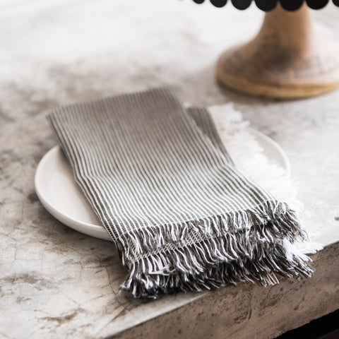 black and white striped napkin with frayed edge