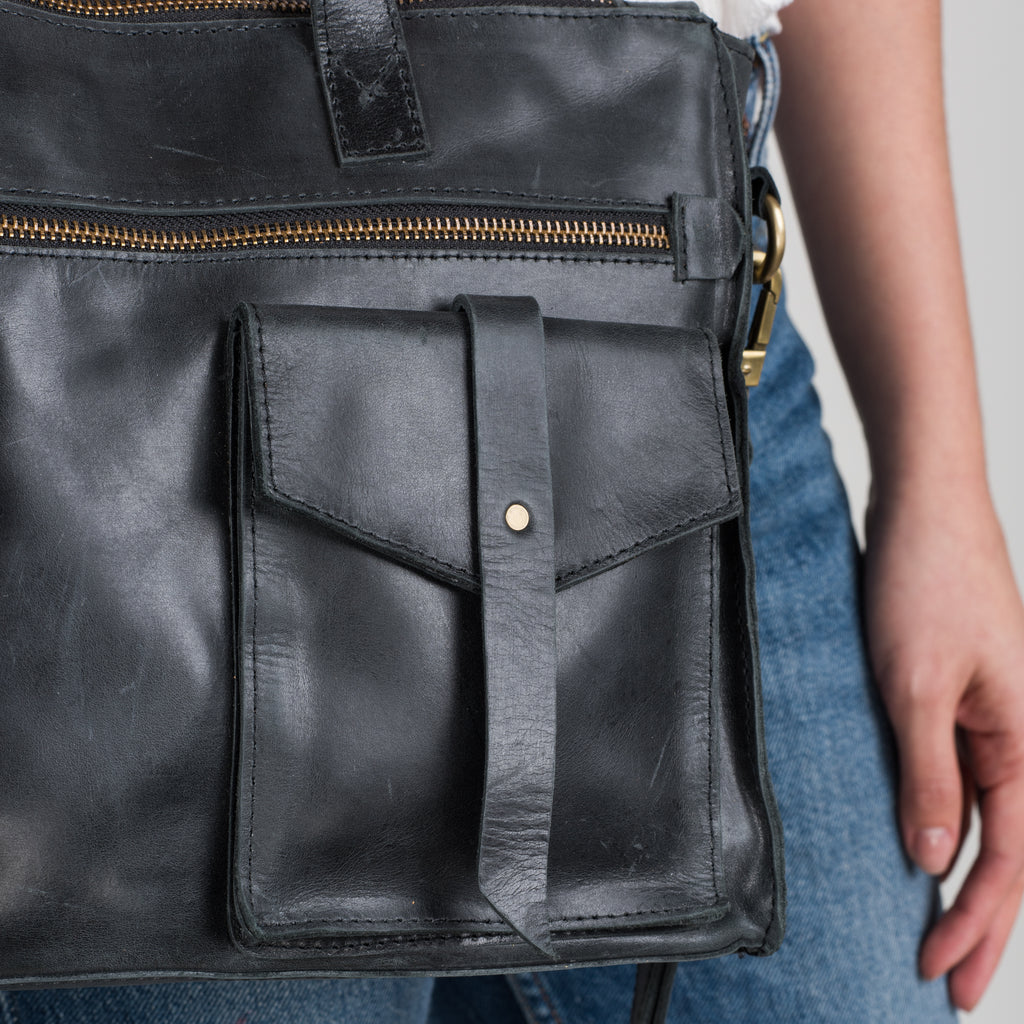 black leather satchel with pockets