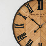 wood wall clock with black metal roman numeral numbers
