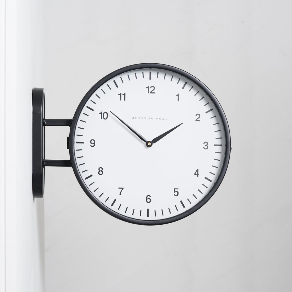 black metal two-sided wall clock
