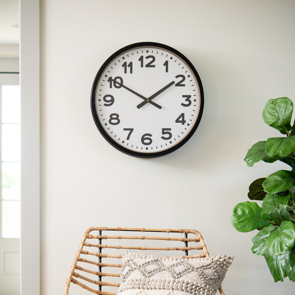 black metal framed wall clock with white face and bold black numbers