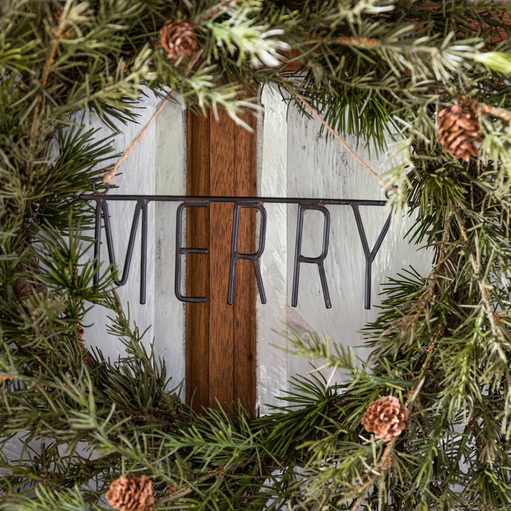 "black metal ornament of the word ""MERRY"""