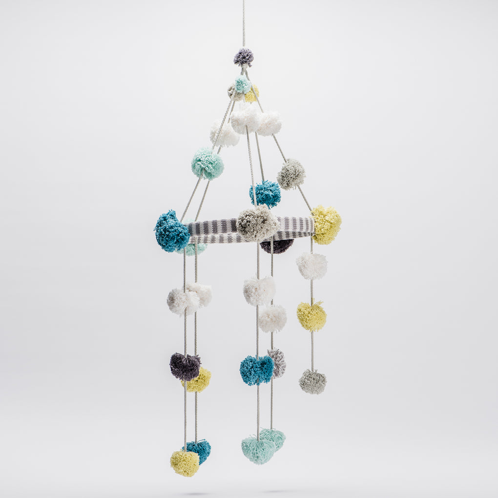 multi colored pom pom baby crib mobile