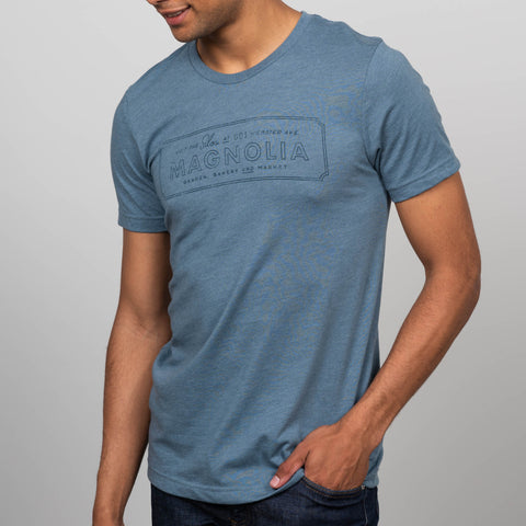 muted blue t-shirt with rectangular magnolia logo on chest