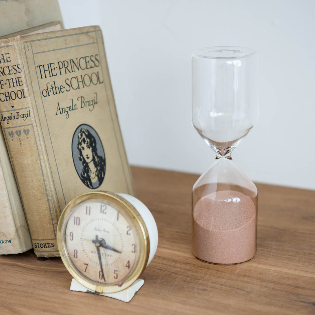 clear glass hourglass with blush pink sand